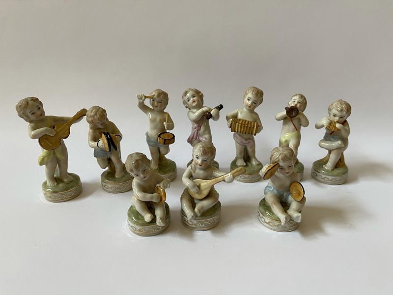 Porcelánová kapela amorků 10 ks